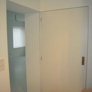 Gelijkliggende deur zonder deurlijst